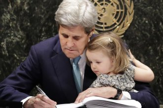 Then-Secretary of State John Kerry holds his granddaughter as he signs the Paris Agreement on climate change in April 2016. Kerry has been chosen as climate envoy in the incoming Biden administration.