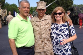 Marine Capt. Cristian Alphonso, center, pictured with his parents, Bonny, left, and Karen, right, in 2014. Alphonso was unable to visit his parents before an upcoming deployment because of Defense Dept. travel restrictions.