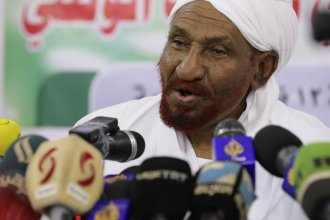 Former Sudanese Prime Minister Sadiq al-Mahdi, pictured in Feb. 2020, died after being infected by the coronavirus.