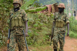 Soldiers patrol outside presidential challenger Bobi Wine's home in Magere, Kampala, Uganda, Jan. 16, after President Yoweri Museveni was declared the winner of the election.