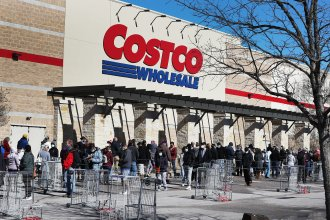 People wait to shop at a Costco in Texas on Feb. 20. Next week's pay increase would put Costco ahead of much of the industry.