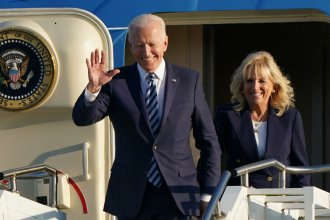 President Biden and first lady Jill Biden arrive on Air Force One at RAF Mildenhall in Suffolk on June 9 ahead of a series of summits and meetings in Europe.