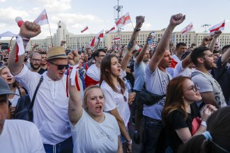 People with old Belarusian national flags shout during an opposition rally in August in Minsk, Belarus.