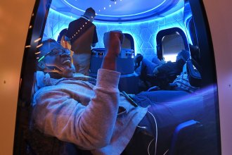 Participants sit a Blue Origin space simulator during a conference on robotics and artificial intelligence in Las Vegas on June 5, 2019. On Saturday, Blue Origin announced that an unidentified bidder will pay $28 million for a suborbital flight on the company's New Shepard vehicle.