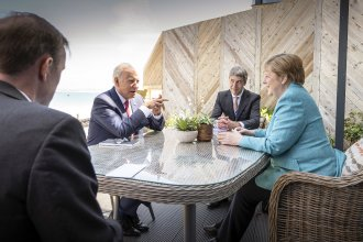 """President Biden meets with German Chancellor Angela Merkel on the sidelines of the G-7 summit. A White House official said Biden did a lot of """"diplomatic speed-dating"""" with world leaders."""