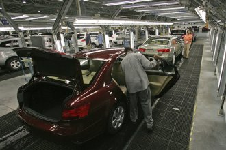 Hyundai Motor Company employees put the finishing touches on vehicles in Montgomery, Ala.