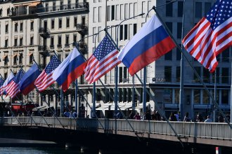 U.S. and Russian flags fly on the Mont-Blanc bridge on the eve of a US-Russia summit on Tuesday in Geneva. A former intelligence operative says agencies are in high gear.