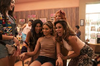 Singer and actor Leslie Grace stars as Nina Rosario (center), the beloved and brilliant neighborhood sweetheart in the film adaptation of the musical <em>In the Heights.</em>