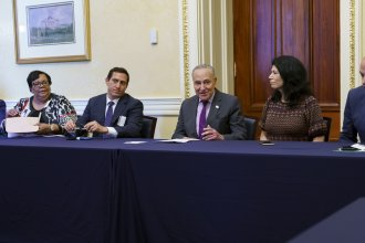 Senate Majority Leader Chuck Schumer, D-N.Y., is flanked by Texas Rep. Trey Martinez Fischer left, and Texas Sen. Carol Alvarado of Houston, right, as he meets with Texas Democratic lawmakers to discuss voting rights Tuesday on Capitol Hill.