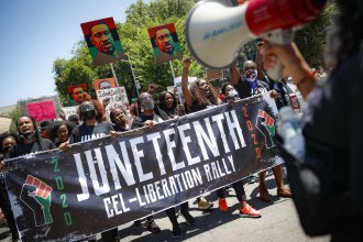 Protesters chant last year as they march after a Juneteenth rally at the Brooklyn Museum in New York City.