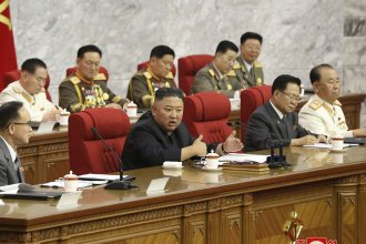 In this photo provided by the North Korean government, North Korean leader Kim Jong Un, center, speaks during a Workers' Party meeting Thursday in Pyongyang. Kim ordered his government to be fully prepared for confrontation with the Biden administration, state media reported Friday, days after the U.S. and other major powers urged the North to abandon its nuclear program and return to talks.