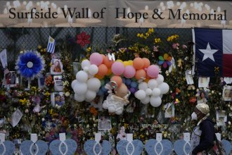 A makeshift memorial pays tribute to the victims of the Champlain Towers South building collapse in Surfside, Fla.