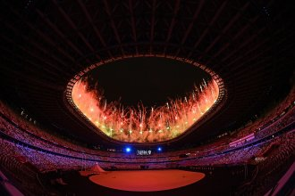 Fireworks go off around the Olympic Stadium during the opening ceremony of the Tokyo 2020 Olympic Games, in Tokyo, on July 23, 2021.