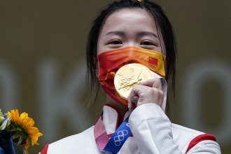 Qian Yang of China celebrates after winning the gold medal in the women's 10-meter air rifle at the Asaka Shooting Range in the 2020 Summer Olympics on Saturday.