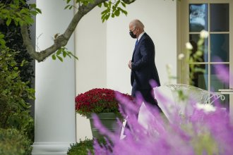 President Biden, pictured leaving the Oval Office on Oct. 15, is traveling to Rome and Glasgow during the second foreign trip of his presidency.
