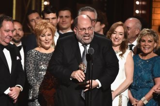 Producer Scott Rudin, center, and the cast of <em>Hello, Dolly!</em> accept the award for Best Revival of a Musical at the 2017 Tony Awards in New York City. Rudin says he's stepping back from his Broadway work.