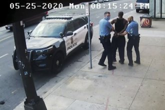 This image from video shows Minneapolis police officers Thomas Lane, left, and J. Alexander Kueng, right, escorting George Floyd, center, to a police vehicle outside Cup Foods in Minneapolis, on May 25, 2020. The image was shown as prosecutor Steve Schleicher gave closing arguments in the trial of Derek Chauvin for the death of Floyd.