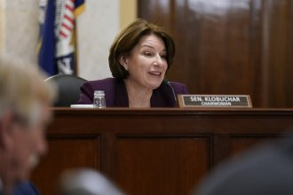Senate Rules Committee Chair Amy Klobuchar, D-Minn., presides Tuesday over a markup of the For the People Act, which would expand access to voting and make other election reforms. House Democrats passed the bill in March.