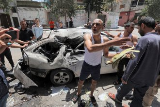 In Gaza City on Wednesday, Palestinians inspect a vehicle destroyed by an Israeli airstrike after the bodies of its passengers and driver were retrieved.