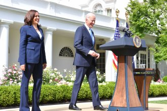 President Biden arrives with Vice President Harris to discuss the CDC's new mask guidance in the Rose Garden of the White House on Thursday.