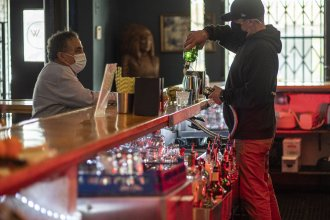 A bartender mixes a drink inside a bar last week in San Francisco. The latest retail sales data out on Friday showed an increase in sales at restaurants and bars as more people venture out amid the continued reopening of the U.S. economy.