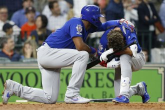 Albert Almora Jr. of the Chicago Cubs is comforted by Jason Heyward after a young child was injured by a foul ball off Almora's bat. The accident happened on May 29 in the fourth inning of a game against the Houston Astros at Minute Maid Park in Houston.