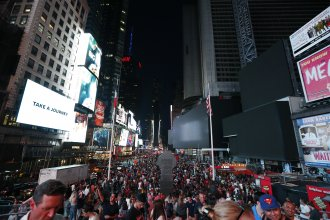 Authorities scrambled to restore electricity to Manhattan following a power outage that knocked out Times Square's towering electronic screens and left businesses without electricity, elevators stuck and subway cars stalled.