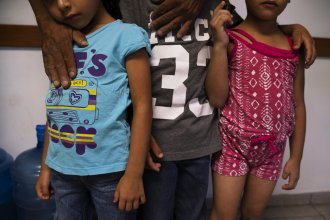 Giovani, with his son Jonathan (center), and twin daughters Catherine and Carla at a shelter in Ciudad Juárez. Giovani says that care has been hard for the family to get in Juárez.