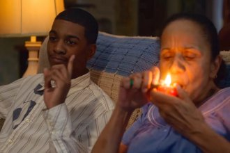 Brett Gray (left) as Jamal Turner, and Peggy Blow as Abuela, a lovable, pot-smoking grandma, in the first season of the Netflix teen drama <em>On My Block</em>.