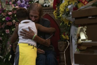 Antonio Basco hugs a boy at the memorial service for his wife, Margie Reckard, at La Paz Faith Memorial and Spiritual Center in El Paso, Texas. Basco, who doesn't have many local friends and family, invited the public to attend.