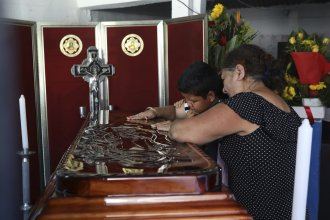 Twelve-year-old Jesús Ruiz grieves as he stands before the coffin containing the remains of his father, Mexican journalist Jorge Celestino Ruiz Vazquez, in Actopan, Veracruz, on Aug. 3. The Committee to Protect Journalists said Ruiz Vazquez was the third journalist killed in a single week in Mexico.