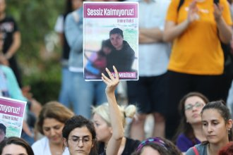 "Women protest against women's murders in Ankara, Turkey, on Aug. 23. Signs say ""We are not silent"" and show Emine Bulut, whose killing by her ex-husband was captured on video that was widely shared on social media."