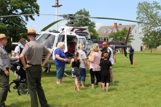 Visitors and park rangers at historic Fort Scott check out a medevac helicopter operated by Midwest AeroCare during the Kansas town's Good Ol' Days festival.