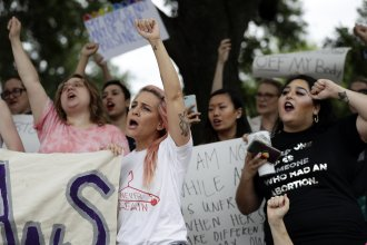 A group gathers at the state capitol in Austin, Texas, in May to protest abortion restrictions. In defiance of the state's ban on city funding of abortion providers, the Austin City Council has found a workaround to help women seeking the procedure.