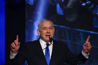 Israeli Prime Minister Benjamin Netanyahu addresses his supporters at party headquarters after elections in Tel Aviv, Israel, on Wednesday.