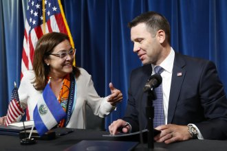 Acting Secretary of Homeland Security Kevin K. McAleenan, right, with Alexandra Hill, left, Minister of Foreign Affairs for El Salvador, after signing an asylum agreement in Washington, D.C.