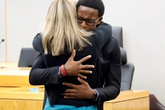 Brandt Jean, Botham Jean's younger brother, hugs former Dallas police officer Amber Guyger in court after saying he forgives her for killing his brother. Guyger received a 10-year prison sentence for murder.