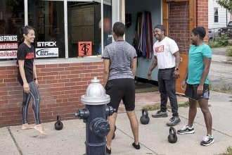 Justice Williams with gym goers and kettlebells at CORE in Brookline, Mass.