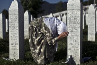 A woman weeps as she visits the grave of a family member killed in the 1995 massacre at the Potocari memorial complex near Srebrenica, Bosnia and Herzegovina, on Saturday.