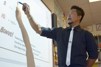 """Raymond Cabahug moved from the Philippines to teach math in the U.S. He likes life in """"peaceful"""" Bethune, Colo."""