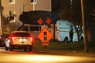 Police operate outside the Cameo Night Club after a reported fatal shooting on Sunday in Cincinnati.