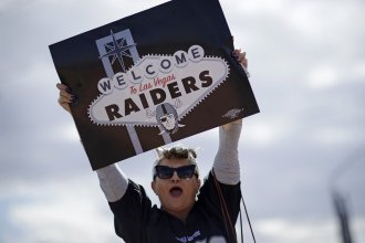 A fan celebrates Monday in Las Vegas, after NFL team owners approved the Raiders' move to the city.
