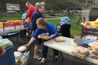 Volunteers distribute free food at the mobile pantry in Hurley, Va. Poverty in the coal-mining region is 29 percent, twice the national average. Unemployment is also high, and younger families are moving out.