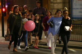 People leave Manchester Arena in England on Monday night, after an explosion that killed 22 people and wounded dozens more.