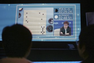 Spectators watch the world's top-ranked Go player, Ke Jie, square off against Google's artificial intelligence program, AlphaGo, during the Future of Go Summit in Wuzhen, China, on Tuesday. The program beat Ke in the first of three matches.