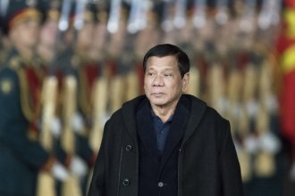 Philippine President Rodrigo Duterte reviews guards just outside Moscow late Monday. He announced Tuesday night he would be cutting his Russia visit short due to violence on Mindanao, where he declared martial law.