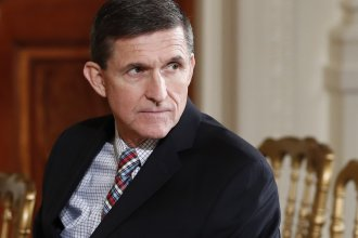 Former national security adviser Michael Flynn sitting in the White House in February. The Senate Intelligence Committee announced it has subpoenaed two companies owned by Flynn.