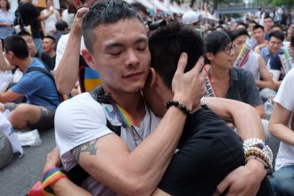 Same-sex activists hug outside Taiwan's legislature in Taipei Wednesday, after a landmark decision was announced that paves the way for the island to become the first place in Asia to legalize gay marriage.