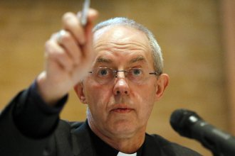 "Justin Welby, the archbishop of Canterbury, seen at a news conference last year. The Anglican spiritual leader says the Church of England ""colluded"" with one of its former bishops to hide the bishop's sexual abuse of boys and young men."