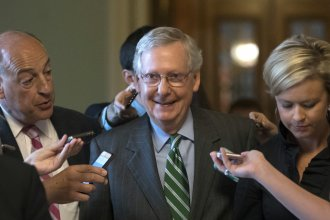 Senate Majority leader Mitch McConnell eaves the chamber after announcing the release of the Republicans' health care bill on Thursday.